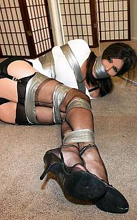 Tied wife rolls on the floor