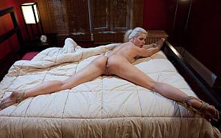 Tied to bed and having her pussy exposed