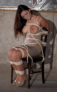 Captired woman is tied and tape gagged