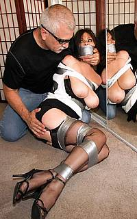 Housewife bound and gagged with duct tape