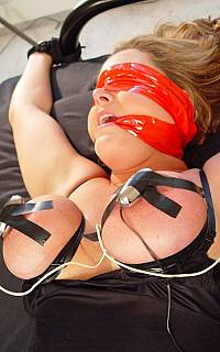 Electrified boobs of bed bound slave