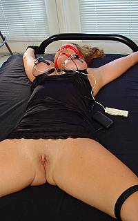 Big tits os bondage slave are shocked with electricity