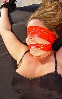 Duct tape is used for gagging and blindfolding the girl