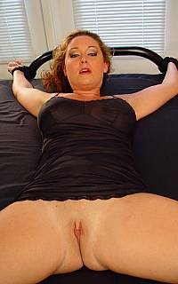Tied to bed MILF is having her shaved pussy exposed