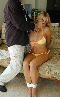 Housewife is tied up while wearing bikini