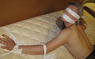 Giel blindfolded and gagged with cloth