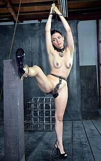 Kinky medieval pussy device for cuffed slave