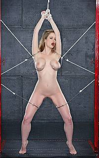 BDSM girl is tortured with barbed wire