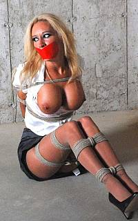 Captive secretary is tied up and tape gagged