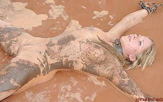 Chained girl is all all soiled with mud