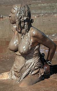 Cuffed girl is covered with dirt