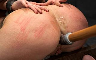 Rubber cock in tighs ass of BDSM slave
