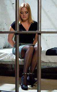 Handcuffed MILF behind the bars