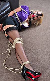 Bound MILF is trying to escape her bondage