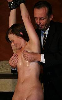 Girl is tortured with her nipples twisted (Mar 2013)