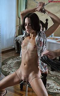Chained woman pussy torture