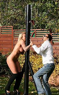 Handcuffing woman to the whipping post