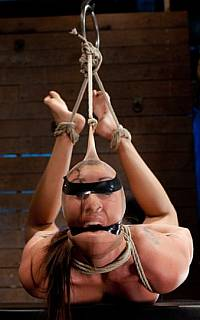 Hogtied girl is tape gaggd and blindfolded
