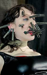 Face of the girl is distorted with clothes pegs