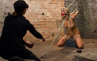 Girl is put in strappado bondage and whipped