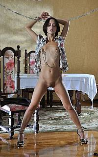 Nude girl is cuffed and chained