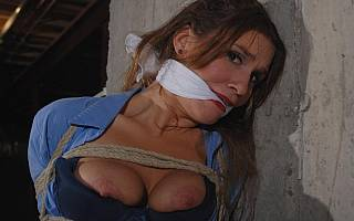 Exposed tits of the scarf gagged woman