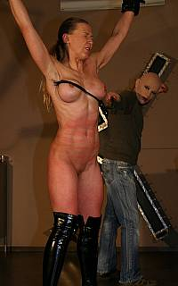 Lashing BDSM girl tits with a whip