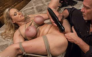 Ass fisting the woman in bondage