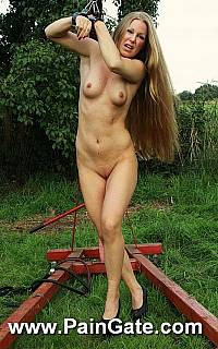 Shackled slut is posing naked outdoors (Aug 2013)