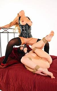 Lesbian in bondage is pleasuring the dominatrix