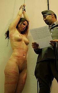 Soldiers are whipping the cuffed girl