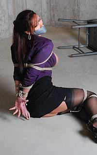 Girl is trying to escape the bondage ropes (Nov 2013)