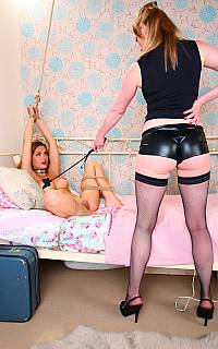 Lesbian slave is enjoying pussy whipping