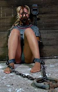 Woman is straightjacket is locked in shackles (Nov 2013)