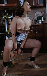 Clamped and chained young woman