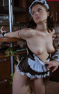 Handcuffed maid with exposed tits