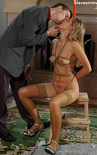 Sexy BDSM lover is tied up with ropes
