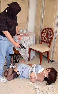 Using the gun to keep gagged slut quiet