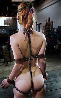 BDSM device includes cuffs, chains and collar (Jan 2014)