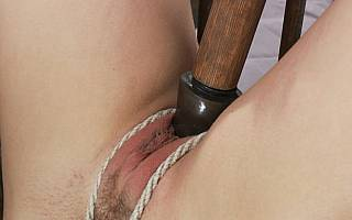 Roped pussy is fucked with dildo
