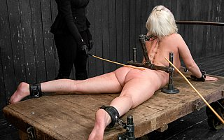 Back-bending BDSM rack and ass canning torment
