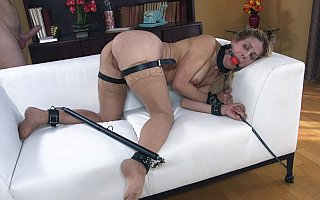 Cherie DeVille bound with leather belts and spread-bar