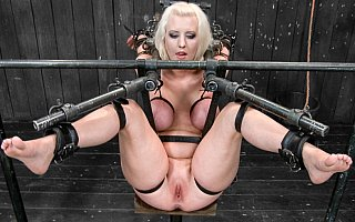 Cherry Torn suspended in bizarre BDSM rack