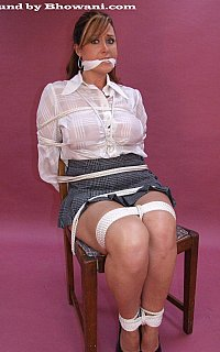 Damsel in distress scene where MILF secretary is tied to chair