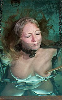Dipping helpless slave into the water where she could drown