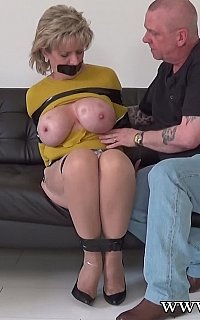 English trophy wife is tied and her big boobs are exposed