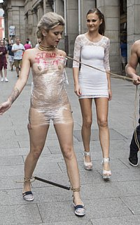 Exposing nude slavegirl wrapped in plastic on public