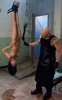 Nude gal is whipped in suspension