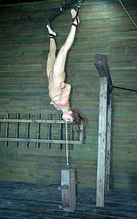Upside-down suspension and rope strangling BDSM
